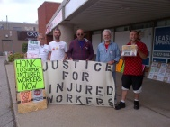 "At the end of the car flyering session Around 4:00pm, the guys from ""Justice for Injured Workers"" show up to protest outside Ken Coran's office. They are pleased to be joined by 2 OSSTF activists (the third is busy at a nearby hospital parking lot, flyering the cars of health workers there with ""Don't Vote Liberal"" slips."